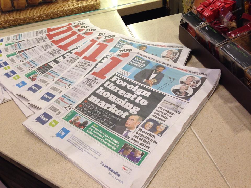 レジ前においてあるニュースペーパー